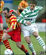 Stilian Petrov chases Thistle striker Alex Burns