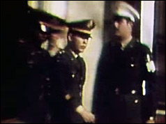 Lieutenant Calley (centre) leaves court after being found guilty