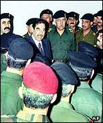 Saddam Hussein with his generals