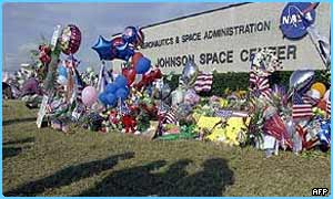 Flowers and balloons have been left outside the Johnson Space Center