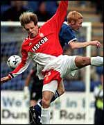 St Johnstone's Nathan Lowndes and Monaco's Bruno Irles
