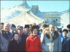 Nixon and wife with crowd on the Great Wall of China