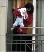 Michael Jackson with his son on a hotel balcony