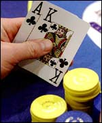 A poker hand and chips