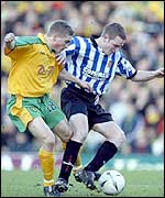 Norwich's Mark Rivers and Dagenham's Mark Rooney
