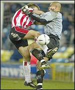 James Beattie challenge Millwall keeper Tony Warner