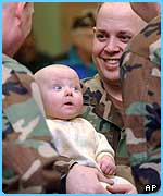 An American soldier leaving for Iraq says goodbye to his baby
