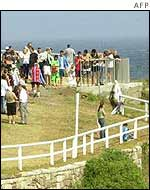 Crowds gather at Coogee Beach to see the Virgin Mary