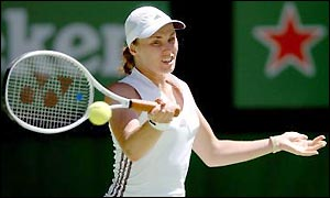 Hingis and Capriati battle in the blistering heat but Capriati takes the title