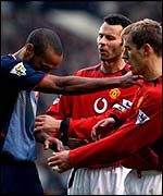 Arsenal striker Thierry Henry and Manchester United's Phil Neville