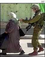 Israeli soldier and Palestinian woman