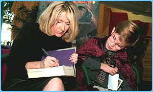 JK Rowling signs a book for a fan