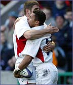 Ben Cohen congratulates Jason Robinson following his try against Scotland last season