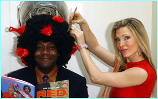 Caprice gives Lenny Henry a new do, to show  the theme of this year's Comic relief...