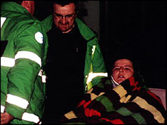 Paramedics take an injured woman to hospital