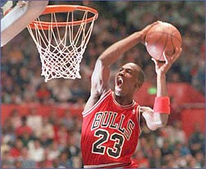 Michael Jordan rises above the basket to make a spectacular slam dunk