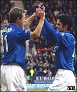 Neil McCann celebrates with Mikel Arteta