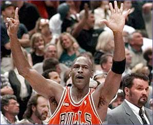 Michael Jordan holds up six fingers to the crowd
