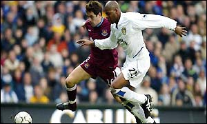 Duberry battles with Joe Cole as he replaces the injured Lucas Radebe in defence
