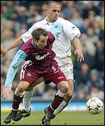 West Ham's Lee Bowyer is closely watched by Leeds debutant Raul Bravo