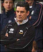 Derby manager John Gregory watches from the Fratton Park sidelines