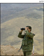 Soldier looking at Ansar al-Islam positions in northern Iraq