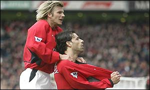 Ruud van Nistelrooy celebrates with David Beckham