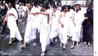 Men in wearing special white clothes (called Ihram)