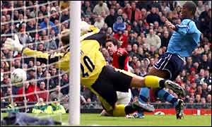 Ruud van Nistelrooy scores the opener in the Manchester derby