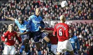 Shaun Goater rises to head the equaliser in the Manchester derby