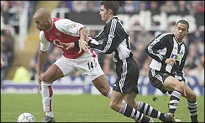 Thierry Henry gives the Newcastle defence a torrid time in the first half