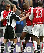 Alan Shearer (left) and Patrick Vieira exchange words at St James' Park