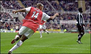 Henry wheels away after his 18th Premiership goal of the season
