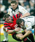 Hull's Scott Logan(top) and Adam Maher tackle Halifax's Chris Birchall