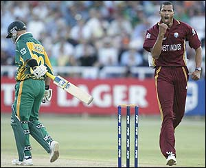Mervyn Dillon  takes the wicket of Herschelle Gibbs