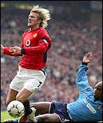 Manchester City's David Sommeill challenges David Beckham