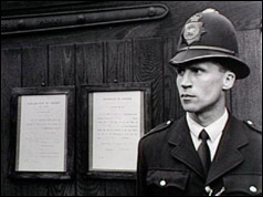 Photo of a policeman outside Holloway Prison