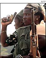 Woman Ivory Coast rebel holding gun