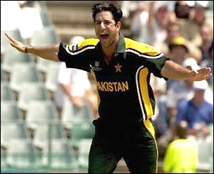 Wasim Akram celebrates the wicket of Damien Martyn