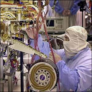 Engineer finishes the assembly of one of two Mars rovers inside a clean room at the Spacecraft Assembly Facility in Pasadena, California