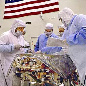 NASA scientists and engineers work on a portion of a scientific instrument assembly