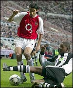 Robert Pires in action against Newcastle's Titus Bramble