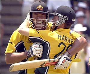 Andrew Symonds and Ian Harvey embrace as Symonds reaches his century
