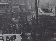 Banner-waving demonstrators walked down Oxford Street