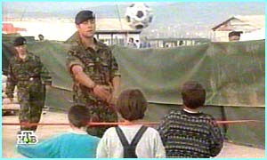 Nato soldiers play football with kids in Kosovo