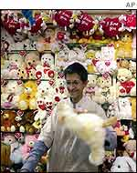 Shopkeeper with Valentine's Day goods in Bombay