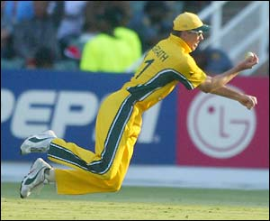 Glennn McGrath dives to catch Waqar