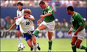 Roy Keane powers a shot towards the Italian goal at the 1994 World Cup