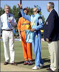 Captains Sourav Ganguly and Roland Lefebrve toss the coin ahead of their World Cup opener in Paarl