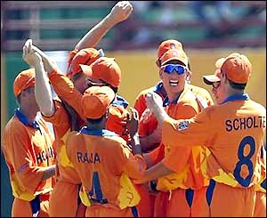 Netherlands celebrate the wicket of Virender Sehwag